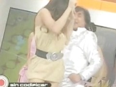Sexy singer in a TV show lets the audience see up her skirt