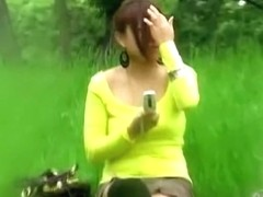 Busty Asian in a yellow shirt skirt sharked in the park