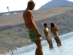 Sexy teeny babes topless on a beach get filmed by a voyeur camera