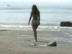 A naked blonde and a golden haired beauty in a beach porno vid