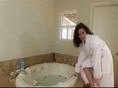 Hairy lady fingers her snatch in the tub