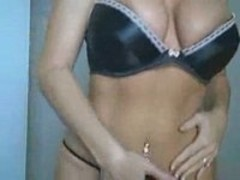 MILF dances in lingerie for camera