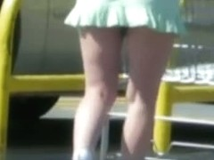 Good looking teen in accidental up skirt shot in a parking lot