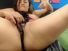 Lady fingers her wet pussy, natural hangers