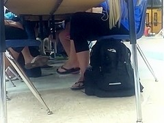Girls dangling flip flops during lunch 2