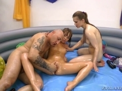 2 lubed up babes taking 10-Pounder in their booties
