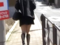 Charming sexy girl experiencing sharking attack during broad daylight