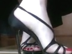 Lady shows off manicured feet in high heels