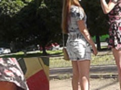 The upskirt view of two young sexy girlfriends