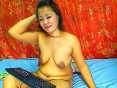 OLDER THAI LADY SHOWING HER LARGE WHOPPERS ON WEB CAMERA