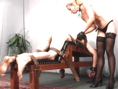 Hot cruel blonde nude mistress caning her slave on caning bench
