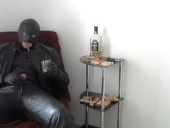 leather biker rubber mask smoke and whisky