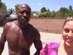 Nella Jay flashes her sexy big tits outdoors