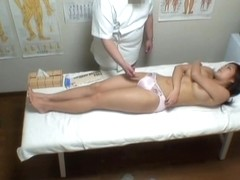 Big-boobed Japanese model gets massaged on camera