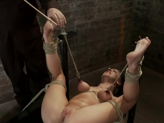 Bound on her back, nipples tied to her big toes. Finger fucked to orgasms, vibrated, caned & abuse.
