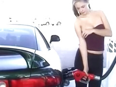 Pretty lady exposes her boobies at the gas station