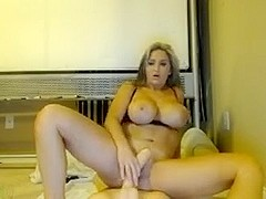 Milf with huge tits sucks a sex toy on webcam