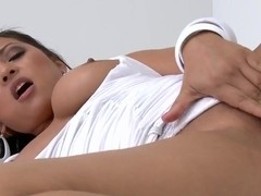 Adriana Luna undresess her white clothes and shows her tanned body