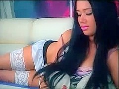 Bewitching Russian camgirl with superb blue eyes makes striptease and masturbates her twat on cam .