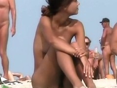 Tanned nude babes on the beach
