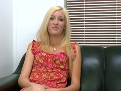 Emily Kae talks and poses during interview