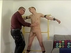 Perverted old hunk and hot twink in gay BDSM fun