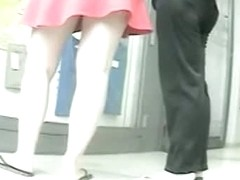 White chick in a pink skirt has her ass observed by a hidden cam