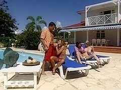 Foursome sex by the pool with two leggy chicks