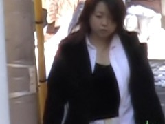 Busty Japanese lady grabbed from behind by a street sharker