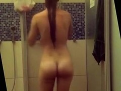 Girl with young elastic body taking a shower.