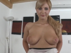 Gorgeous and appetizing buxom blonde plays with her pussy in front of the camera