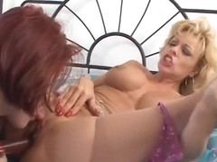 Two sexy girls and two dildos makes for one horny lesbian adventure