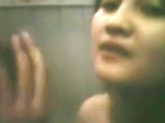 Cute asian girl makes a sextape with her bf in the bathroom