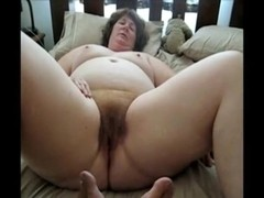 Fingering her taut pussy for the web camera