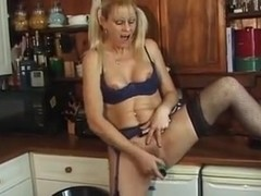 blonde slag toying her twat in the kitchen