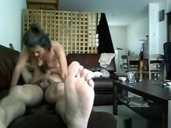 Milf has 69 sex with her husband on the sofa