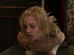 Bratty 19yr old bound on her knees and made to suck cock. Suffers her first suspension, made to cu.