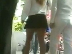 Upskirt video shows a sexy babe in a short skirt.