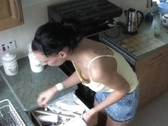 Brunette cutie cleaning in a kitchen down blouse video