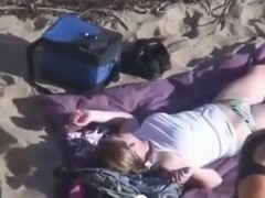 Voyeur can't believe his eyes. strapon lesbian action at the beach !!!