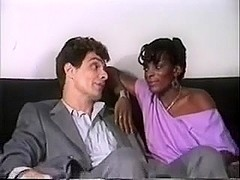 White guy gets a bj from a black gal in vintage porn