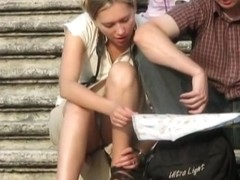 Blonde tourist babe offers an amazingly hot upskirt view