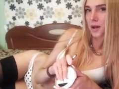Pretty JennyRolls plays with a rubber dildo