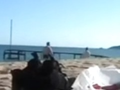 Shameless German couple has torrid sex on the beach