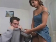Sissy boyfriend gives blowjob to strapon