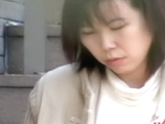 Sharking of a gorgeous Japanese woman sitting on stairs