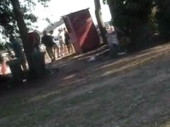 Dude with a camera filming sexy girls in a park
