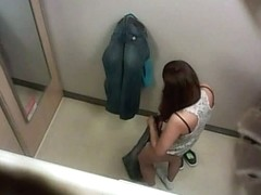 Gorgeous brunette caught changing clothes in the dressing room