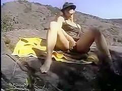Non-Professional wife fisting herself on public beach while hubby filming the fisting masturbation.