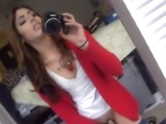 girl tapes herself in the mirror, while masturbating with a dildo.